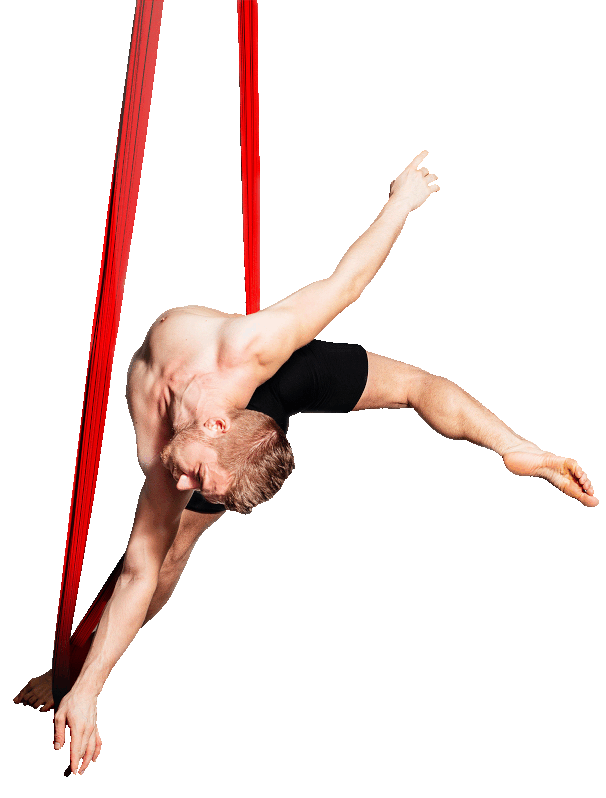 Photograph of a dance student performing a demanding aerial routine.